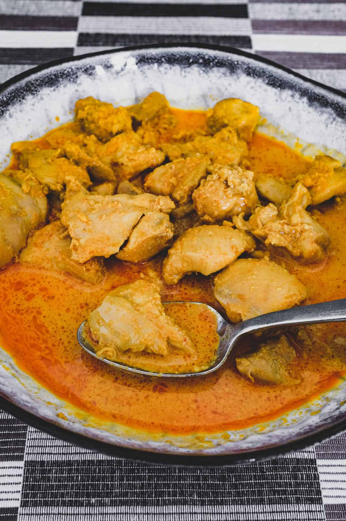 Chicken cooked in coconut milk with Malaysian aromatics to make Nyonya Chicken Curry (Ayam Kleo)